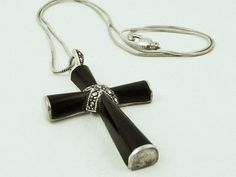 SoVintageous is offering this gorgeous vintage Thai sterling silver, black onyx and marcasite crucifix pendant.  This beautiful piece has a sterling silver foundation with wonderful smooth black onyx