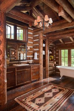 "This reminds me of r house. I LOVE this Rustic bathroom! Nice for a ranch home/hunting lodge. ""Beautiful and rustic log home bathroom with an abundance of warm-toned wood"""