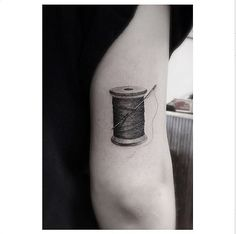 Want a small fashion-inspired tattoo? We love the idea of this spool of thread!