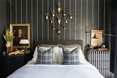 Memphis designer Sean Anderson transforms a dated bedroom into a moody and chic master suite | archdigest.com