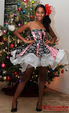 Christmas Wrapping Paper Dress by Yaritza Otero photos by Concepts Photography http://www.facebook.com/PhotographySouthFlorida http://conceptsdandp.com/