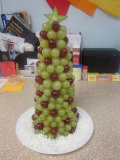 """Christmas Tree Snack    healthy snack for your holiday  You will need a Styrofoam cone, red and green grapes, a star fruit and toothpicks.   It is fun to put it on a plate with some shredded coconut for the """"snow."""""""