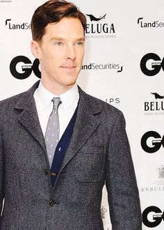 Soo...there's a cardigan under that tweed. Love it. He looks so good here as well.....how is he even real???