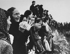 Photograph from the Archiwum Akt Nowych, courtesy of USHMM Photo Archives. Polish civilians mourning the victims during the mass burial in Majdanek after the liberation. (August 1944)