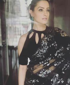 bollywood and TV actress anita hassanandani gorgeous in black & silver sequins saree and cold shoulder, halter like saree choli blouse with cut-outs on neckline and shoulders., and the perfect natural makeup. Shagun Blouse Designs, Sari Blouse Designs, Saree Blouse Patterns, Choli Designs, Designer Blouse Patterns, Fancy Blouse Designs, Blouse Styles, Saree Jacket Designs Latest, Saree Styles