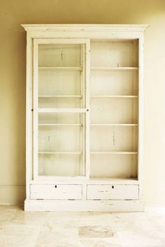 Stunning bookshelf with glass doors - for my growing collection of cake stands & candy jars ;)