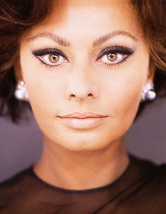 Sophia Loren I can't figure out if her eyes naturally turn up that much at the outside corners, or if its some fabulous trompe l'oeil make-up technique! I hope its the latter!