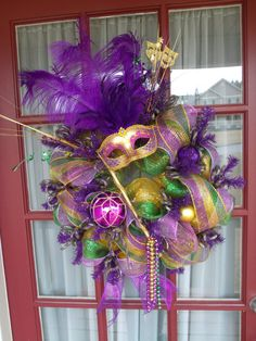 Purple Green and Gold Mardi Gras Deco Mesh Door by CrazyboutDeco, $79.00  I have Mardi Gras beads, any of my girls want to make this for me?