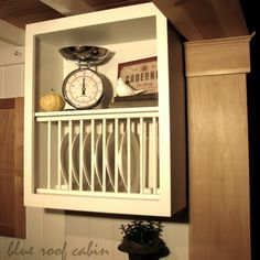 DIY: How to Build a Plate Rack using a Repurposed Cabinet - tutorial shows how a rack was built using an old cabinet. This rack would be perfect for organizing trays in a pantry - via Blue Roof Cabin Cabinet Plate Rack, Diy Plate Rack, Plate Holder, Wooden Kitchen Cabinets, Diy Cabinets, Kitchen Cupboard, Kitchen Sink, Kitchen Racks, Cupboard Doors
