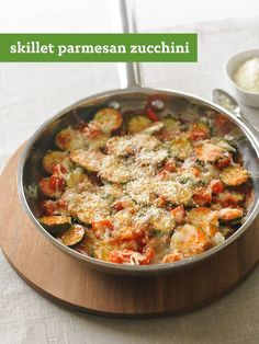 Skillet Parmesan Zucchini recipe - Zucchini and other garden veggies are skillet cooked until crisp-tender before being topped with mozzarella and Parmesan. So easyand so good.