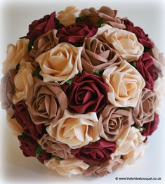 Wedding flowers - autumnal toned brides bouquet of roses burgundy theme wedding flowers - a special order bouquet for bride to be Claire who requested a collection of bridal flowers in burgundy, champagne and mocha roses