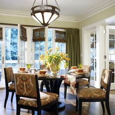 Love the dark bamboo blinds attached to french doors with draperies for privacy, color scheme and lighting