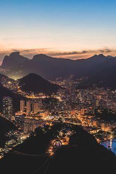 A night view from atop Pão de Açúcar. Far into the horizon is Pedra da Gávea and the beautiful beaches of Ipanema and Leblon. My home town a Cidade Maravilhosa.