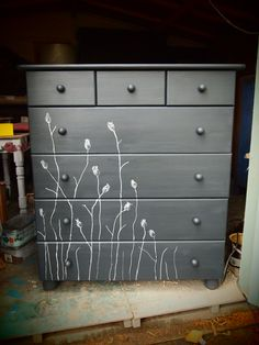 Charcoal grey chest of drawers with silver white and grey plant silhouettes