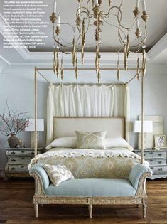French style bedroom with antiqued French commodes and Swedish chandelier.