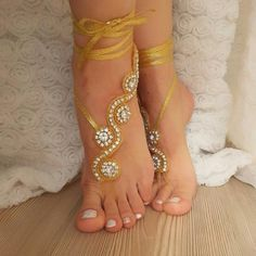 Gold Rhinestone barefoot sandals of good qualityFit to all footReady to ship. Shipment within 24 hours after purchase, weekend 48 hours via post Office.Estimated delivery 15-20 days. customs control may extend this time.purchased with shipping upgrade for immediate delivery, Will be delivered within 48 - 72 hours.Shipping upgrade $18 If any discrepancy or problem , please contact me .