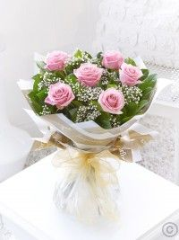 Six Stolen Kisses Pink. This chic, classic hand-tied showcases the very finest large headed pink roses beautifully. The roses and gypsophila complement each other perfectly, and the elegant wrap and ribbon add a sophisticated finishing touch. Online Flower Shop, Order Flowers Online, Pink Flower Bouquet, My Flower, Pink Roses, Pink Flowers, Valentine Flower Arrangements, Pink 2016, Mothers Day Flowers
