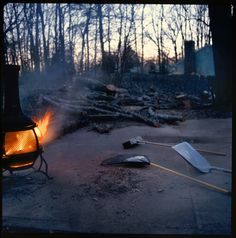 Cleaning up from a hurricane. Night photography. Fire and the oak tree. 120 film.