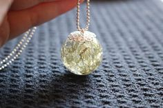 Real Moss and Clear Resin Sphere Pendant https://www.etsy.com/listing/231162236/real-dried-moss-sphere-pendant-moss-and