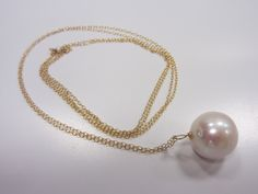 "Large freshwater pearl on 24"" gold-filled chain.  $50 http://kristinpearce.com/asccustompages/products.asp?productid=847"
