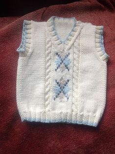 """Ravelry: Argyle Vest pattern by Patons [ """"(Receita gratuita) Ravelry: Argyle V… – Baby Kleidung Crochet For Boys, Crochet Baby, Knit Crochet, Knit Baby Sweaters, Knitted Baby Clothes, Baby Boy Knitting, Knitting For Kids, Kids Knitting Patterns, Baby Patterns"""
