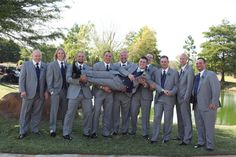 Goofy guys- grey tux with navy blue vest/tie and peacock boutonniere.  Picture by Jared Wanzer