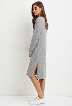Crafted from a lightly textured brushed knit, this sweater dress is complete with a knee-length shift silhouette, V-neckline, and long sleeves.