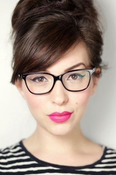 Bright pink lipstick cute makeup for thick framed glasses and bangs.