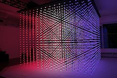 """Deep Screen by Muti Randolph:   This amazing cube of light and sound is the brainchild of Brazilian visual artist Muti Randolph, created for the Creators Project in 2010. Titled """"Deep Screen"""", this interactive installation is made of 6144 motion sensitive spheres of light that react to movement with bursts of sound and color.  Randolph staged this illuminated environment in a way to make the participants feel as if they have entered their computer monitors."""