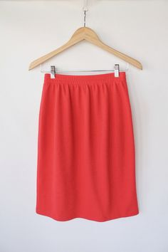Vintage 80s Bright Coral Knit Skirt // Straight High Waisted Pencil Skirt. $30.00, via Etsy.