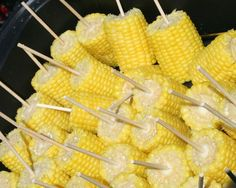 Barn wedding food -corn on cob w/ sticks...look for other pins for how to prepare mass quantities of corn on the cob by putting corn in a cooler and covering it with boiling water