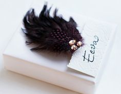 Use a headpiece with feathers to finish of your gift wrapping.