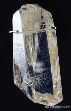Shah Diamond, an 88.7 carat, yellow-tinged, and extremely clear gem of Indian origin that bears inscriptions on three facets. A deep cut in the diamond indicates that it was worn as a talisman. It is believed that the diamond was discovered in the Golconda mines in India in the 16th century, before they were abandoned. According to Tavernier's description, in 1665, the diamond was suspended by a thread before the throne of the Great Moghuls, so that a shah sitting on the throne could look at it