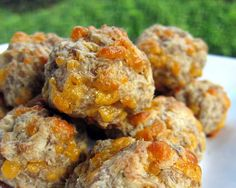 Sausage Balls w/cream cheese. The cream cheese keeps the sausage balls moist and tender. Hot sausage for a little kick, but regular sausage works well, too. 1 lb hot sausage, uncooked.  8 oz cream cheese, softened.  1 1/4 cups Bisquick.  4 oz cheddar cheese, shredded. Preheat oven to 400F.    Mix all ingredients til well combined. Roll into 1 inch balls. Bake 20-25 min.