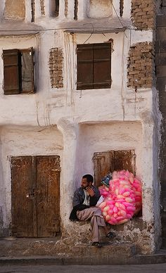 Sana'a, Yemen ~ Cotton candy street vendor takes a break