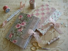 inspiration only, very pretty needle books made from card, laces and felt...website in french, but partially translated...