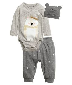 Check this out! CONSCIOUS. Three-piece set in jersey made from an organic cotton blend. Wrap-style bodysuit with printed motif at front, long sleeves, and snap fasteners along side and at gusset. Patterned pants with ribbing at waist and hems. Matching hat with ribbed edge. - Visit hm.com to see more.