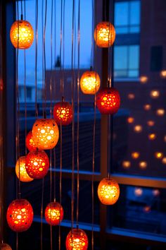 These orange Halloween decorations really stand out from the dark blue background, not only because the two colors are complementary but also due to the differences in brightness. In addition, the varying intensity of light inside the decorations creates a range of saturation.