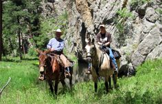 Doug and Renee Bechen riding along French Creek in Custer State Park, South Dakota.