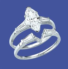 14K Solid White Gold wedding set. 1.25 carat marquise-cut Diamond Essence stone and baguettes on each side and baguettes on other band creates 'v' to fit right with the center stone. 2.25 ct.t.w
