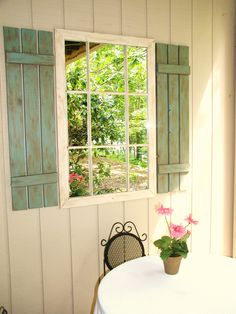 Another way to add a mirror to a plain covered outdoor wall.