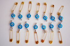 *** ***Light Blue Evil Eye 6mm Flat Glass Beads With Golden Color Safety Pin Turkish evil eye , Nazar Boncugu in Turkish language. Mostly beleived in Turkey, evil eye figure gives people good luck and protects from jealous looks :) This listing is for 50 pieces of glass made