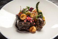 Mezcal braised short ribs, chichilo negro, horchata chochoyotes, sunchoke purée, chile de agua salad.