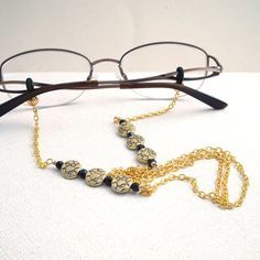 Imagine yourself wearing this classic gold plated eyeglass chain with your reading glasses or sun glasses.