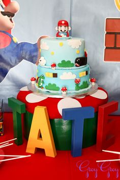 Super Mario Birthday Party! Toadstool cake stand out of old hat box, green paint, felt & hot glue.