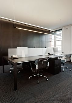 Shared desk space; dividers offer some privacy  Hoyne Designs Dark, Elegant, and Lovely Studio