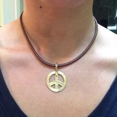 Peace sign Coach necklace Brown leather, peace sign, coach necklace Coach Jewelry Necklaces