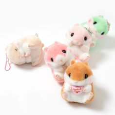 """Don't have time for real hamsters? Then maybe these **Coroham Coron plushies** by ***Amuse*** is just what you need! Fluffy and soft, these **3.5"""" x 3.1"""" x 3""""** plushies dangle at the end of a **ball-chain** so you can take these cuties on the road with you. And just like at the pet store, you have your choice of **5 different** critters: **heart-holding Coron, rosy-cheeked Berry-chan, sweet Minco..."""