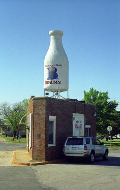 """Route 66 - Giant Milk Bottle. Braum's Milk Bottle in Oklahoma City on Rt. 66. World's largest bottle? No, I've seen bigger roadside bottles, driven thousands of miles to see them, and it occurs to me that I may need to re-evaluate my priorities in life. """"The Fine Art Photography of Frank Romeo."""""""
