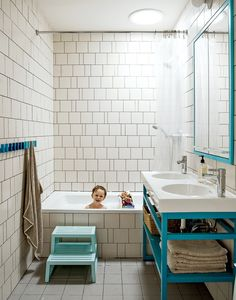 Modern bathroom with irregular tiled wallThe two-bowl sink is the Vitviken model from Ikea; it's topped with a chrome Hansgrohe faucet and accented by Ikea's Godmorgon medicine cabinets customized by the architecture firm MADE. Photo by: Matthew Williams
